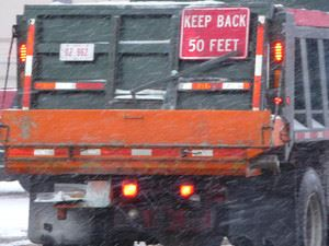 Back of snow plow truck, keep back 50 feet
